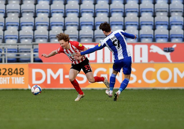 Denver Hume is fouled against Wigan Athletic at the DW Stadium.