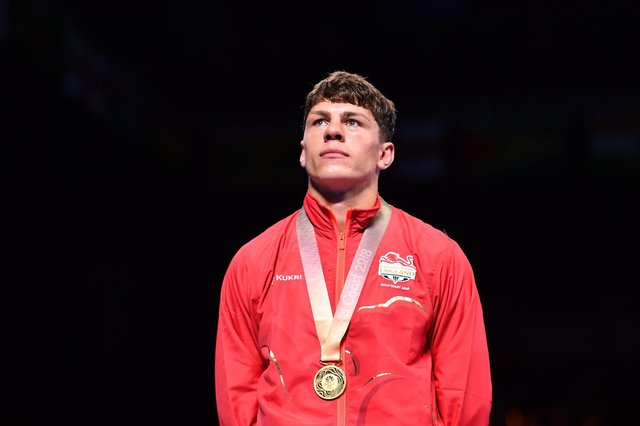 Gold medallist England's Pat McCormack celebrates during the medal ceremony for the men's 69kg boxing event during the 2018 Gold Coast Commonwealth Games at the Oxenford Studios venue on the Gold Coast on April 14, 2018.