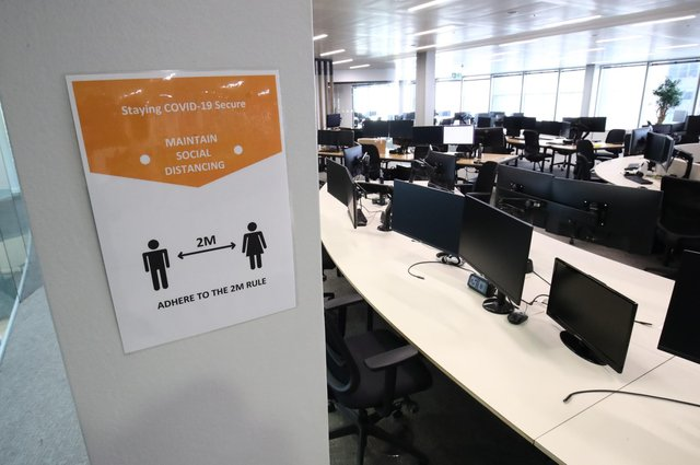 A poster specifying social distancing requirements in a Covid secure office workplace