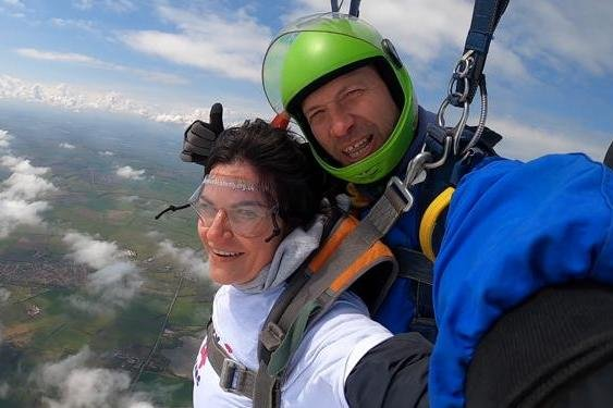 Janine Brown, pictured, carried out the sky dive to help raise money for a national suicide prevention charity.