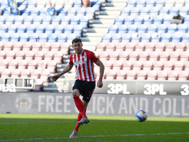 Charlie Wyke scores against Wigan earlier this year