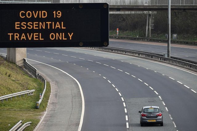 A motorway sign on the M8 advising on essential travel only (Photo: Jeff J Mitchell/Getty Images)