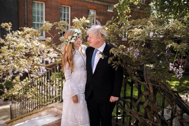 Downing Street photo of Prime Minister Boris Johnson and Carrie Johnson in the garden of 10 Downing Street after their wedding on Saturday. Picture: Rebecca Fulton/Downing Street/PA Wire.