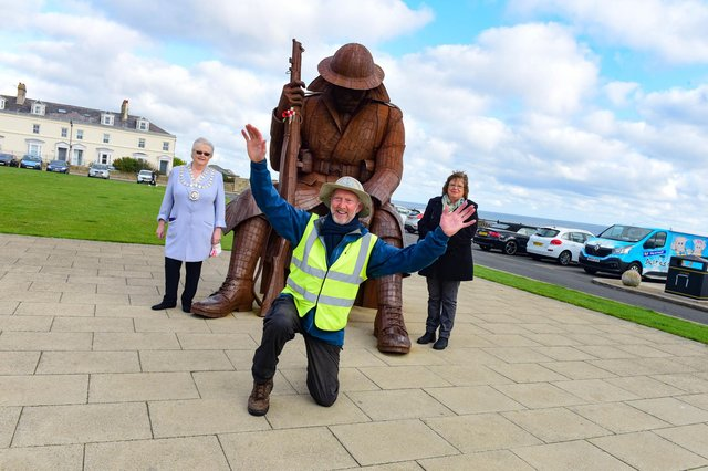 Brian Burnie (centre) fundraiser for Daft as a Brush charity, closing in on completing his 7036 mile walk, next week, by walking from Tommy statue at Seaham to The National Glass Centre, on Saturday. Pictured with Brian are The Mayor and Mayoress of Seaham Coun. Linda Willis (left) and Diane Adamson (right).