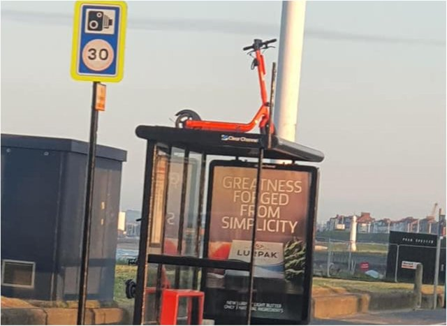 The e-scooter was found on a bus shelter (Photo by Mark Donaldson).